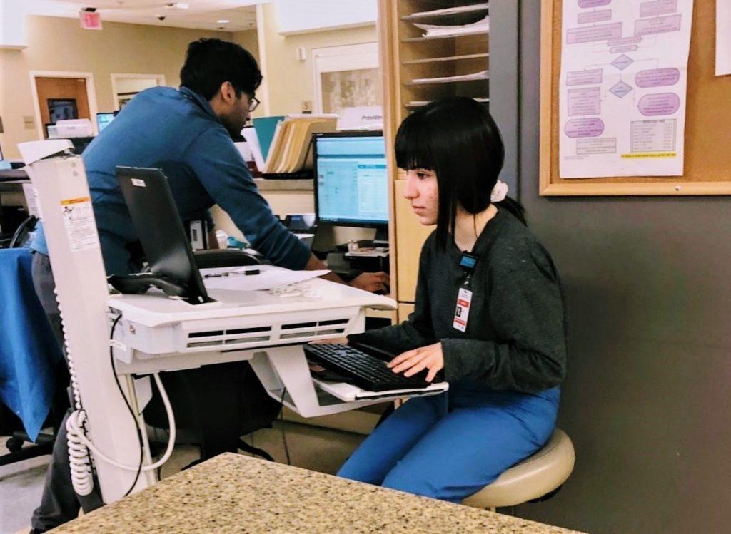 Katrina working as a scribe